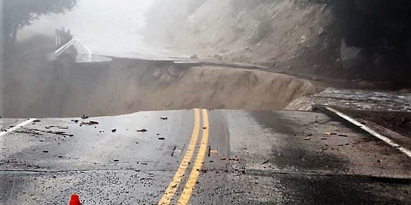 Hwy 243 closed after portions of road swept away