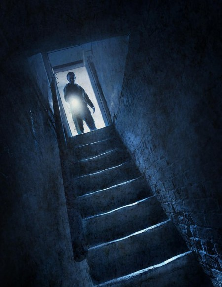 man-with-flashlight-at-the-top-of-cellar-steps-lee-avison