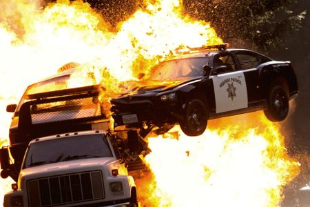cop-car-fiery-crash-need-for-speed-movie