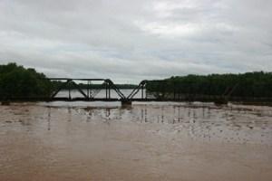 Old RailRoad Bridge at Lewisburg. 9/2011 flood. by Janet Rider