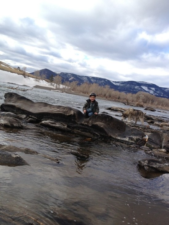 child playing in yellowstone river