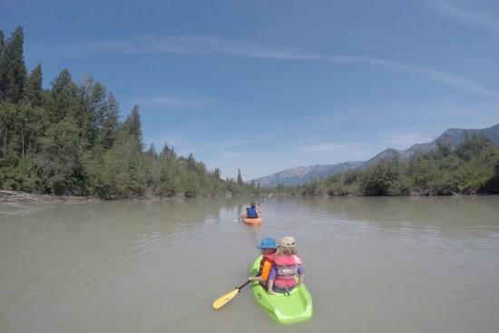 kid-friendly river trip: family paddling down a calm river