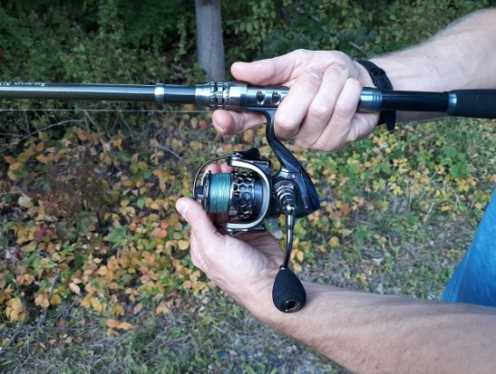 fishing for beginners demonstration: open bail of reel while holding the line