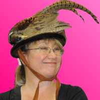 Ms. Butler models a hat fashioned from an entire pheasant