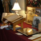 Lippincott family Bible on stand at left
