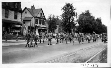 1927 July, Columbus Cadets (Knights of Columbus) marching down Broad St.