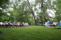Gerald Weaber presides over the final meeting of the season beneath a canopy of trees