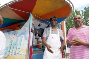 Wade McDaniels, the Snow Cone Man, brings cool treats and cheer to the Riverton Parade.