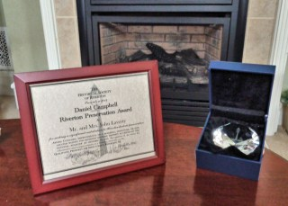Award certificate and etched crystal paperweight