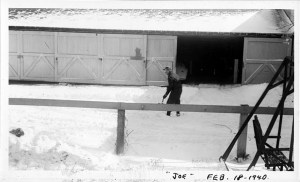 Joseph F. Yearly - shoveling snow in front of J.T. Evans sheds 1940