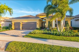 Valencia del Sol CHARLESTON GRANDE  2 Bedrooms 3 Bathrooms Family Room Living Room Club Room Library Screened and Covered Patio 3-Car Garage