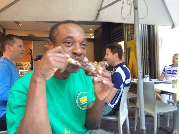 Pre-ride breakfast of Champions: Vinnie chows down on a leg of lamb. photo: Banks