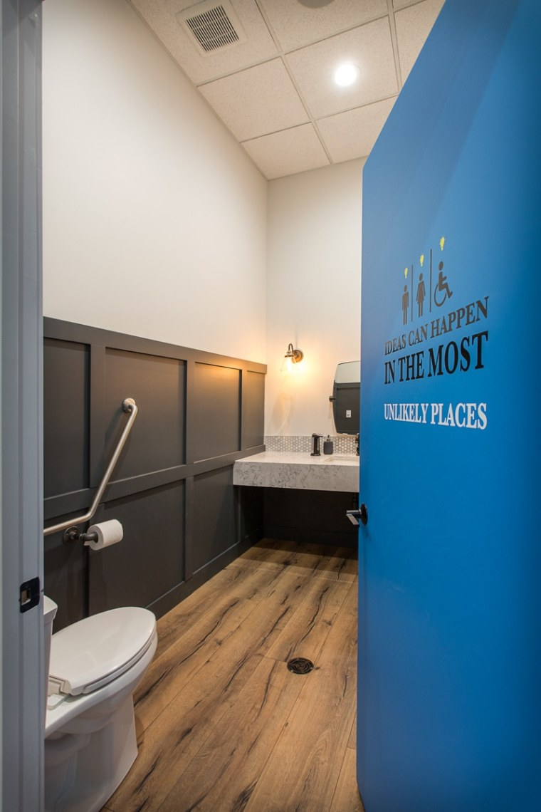 Accessible bathroom,with fun signage, after office renovation.