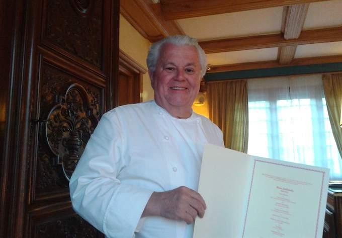 Jany Gleizel with menu at La Bonne Étape