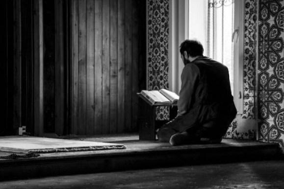 A man reading Quran
