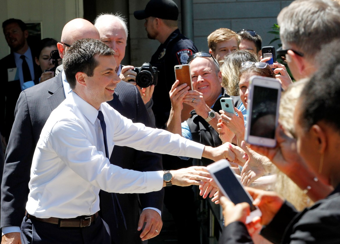 U.S. Democratic presidential candidate Mayor Pete Buttigieg shakes hands with supporters after delivering remarks on foreign policy and national security in Bloomington Indiana