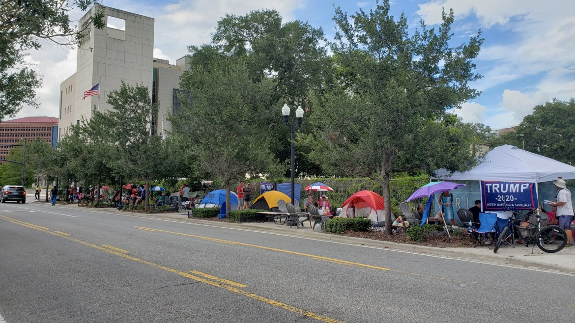 Trump supporters have set up camp since Monday morning, a block away from his reelection rally venue.
