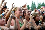 Photo by Rachael Mattice/Journal & Courier) Fans scream during Sleeping with Sirens' set at Warped Tour at Klipsch Music Center in Noblesville, Ind. on Wednesday, July 3, 2013.