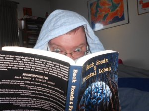 """A """"candid"""" photo of R.J. reading Back Roads and Frontal Lobes"""
