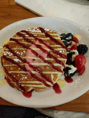 Eating wild berry pancakes for breakfast at Wildberry Pancakes and Cafe