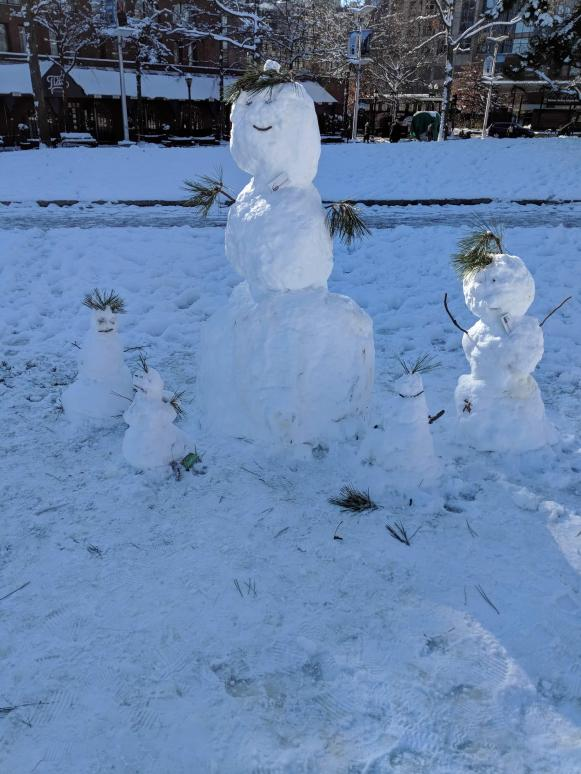 An entire snow family in North End