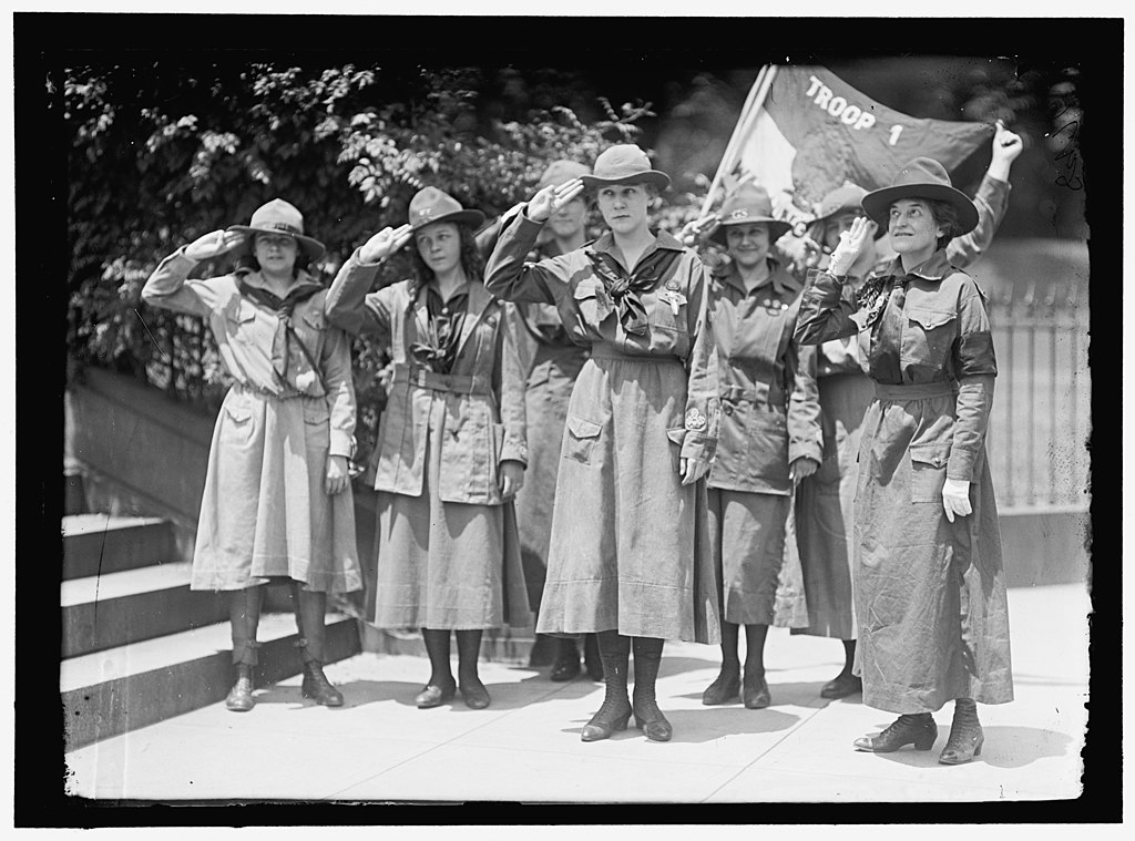 Mrs. Juliette Gordon Low (right), Elenore Puttsske (center), Evaline Glance (2nd from right), along with other girl scouts Harris & Ewing, photographer