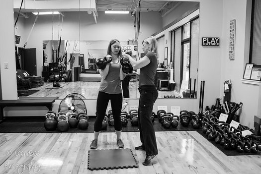 RKC Team Leader Lori Crock Coaching a client with double kettlebells