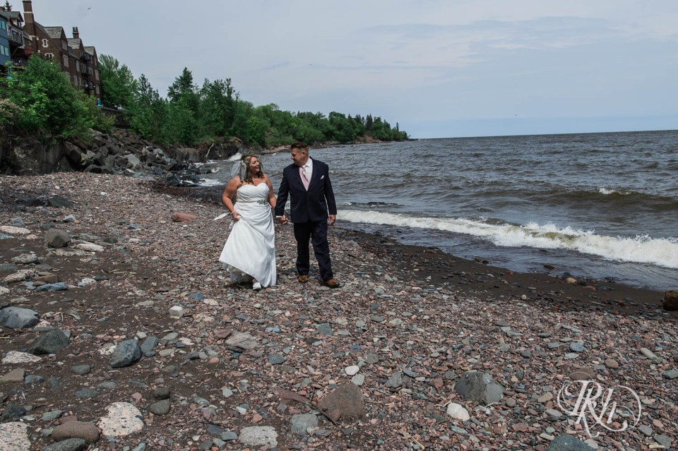 Bride and groom walking along Lake Superior in Duluth