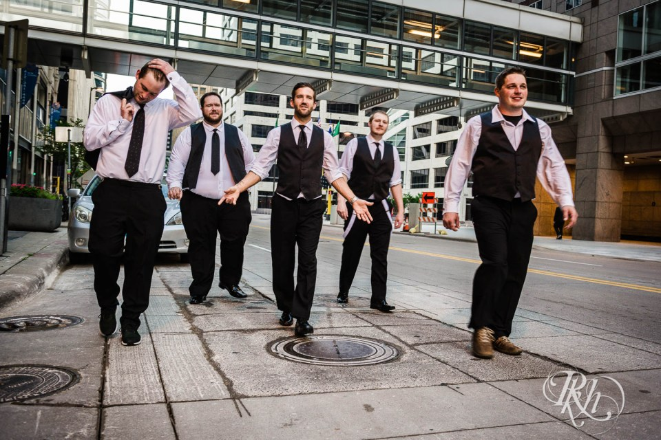 Groomsmen walking down the street
