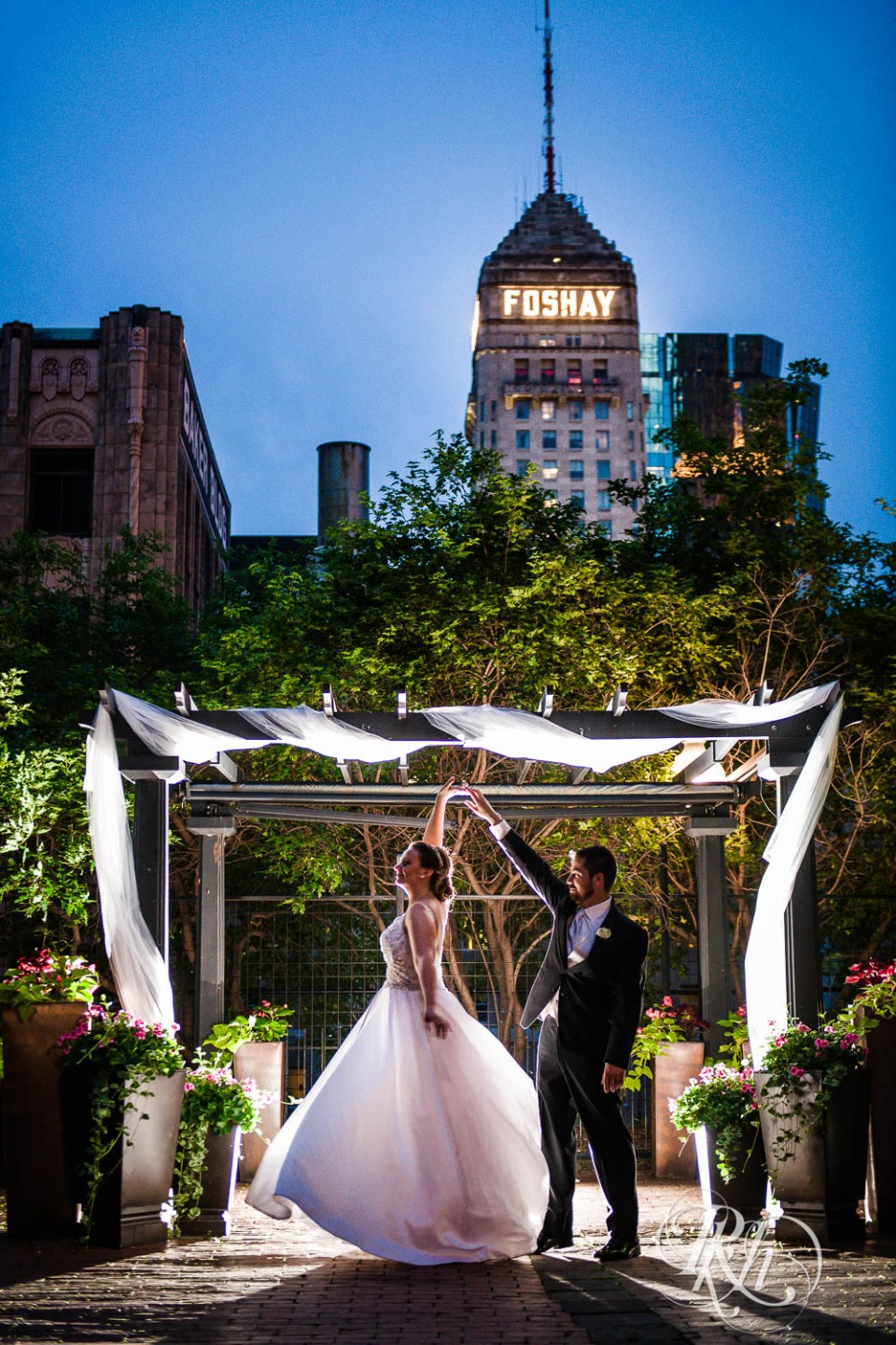 Bride and groom dancing in front of Foshay.
