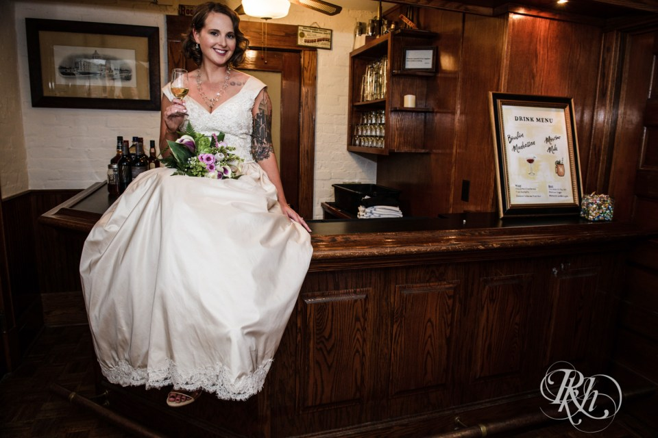 Bride sitting on bar
