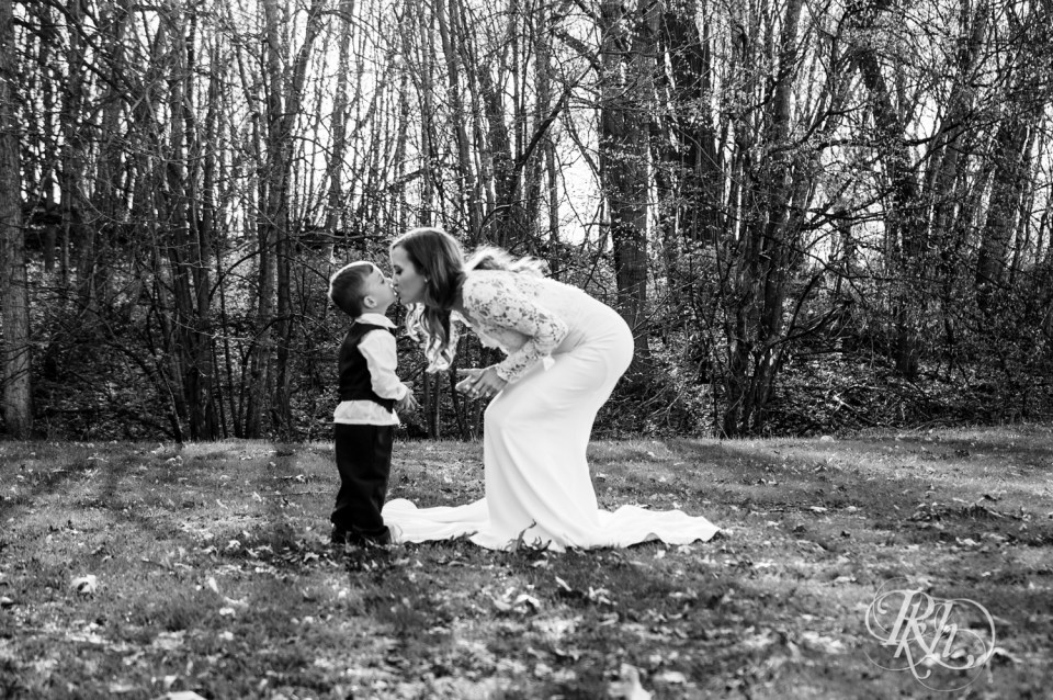 Ring bearer kissing bride