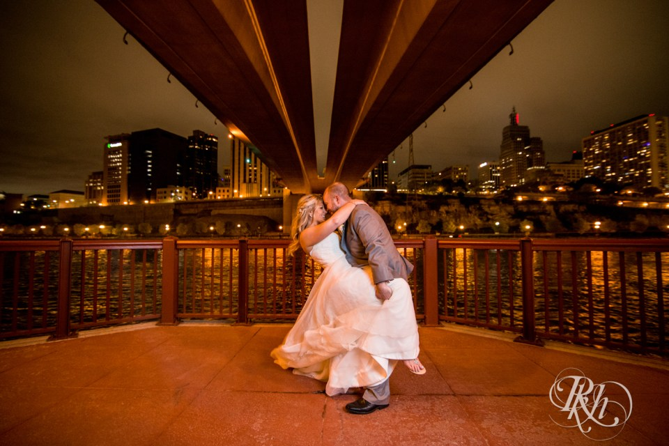 Bride and groom at Minnesota Boat Club under bridge