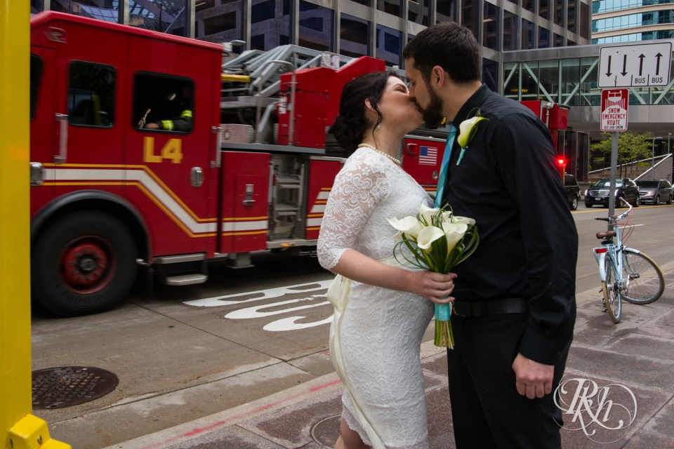 Bride and groom in front of fire truck