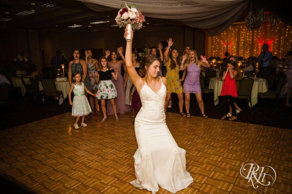 Bride tossing boquet