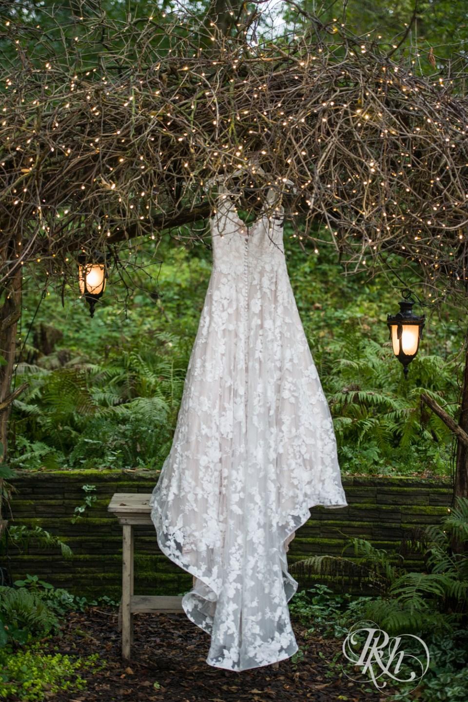 Wedding dress hanging in tree in the rain