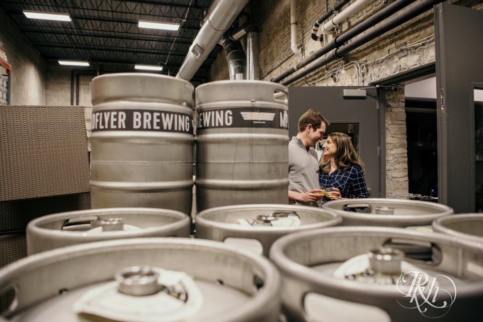 couple standing by beer kegs