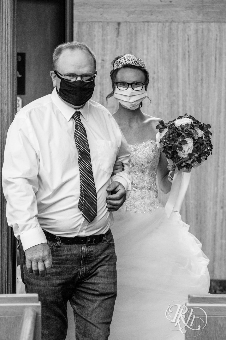 father walking bride with masks