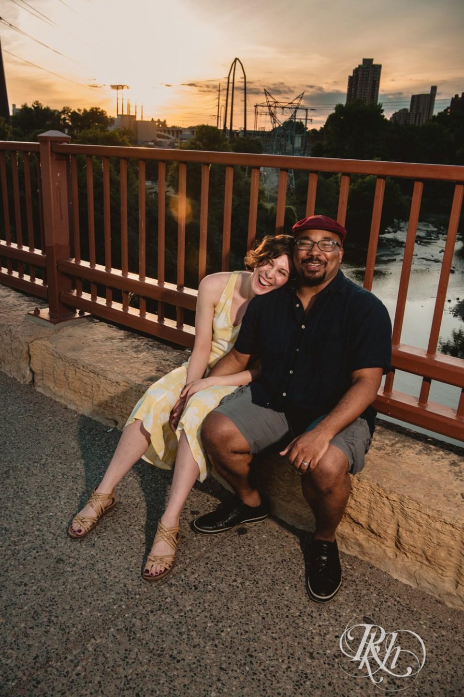 sunset photography stone arch bridge couple sitting on bridge