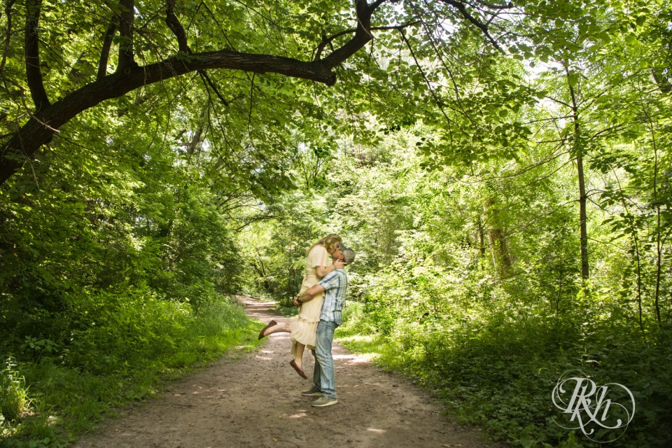 summer engagement photography man lifting and kissing woman