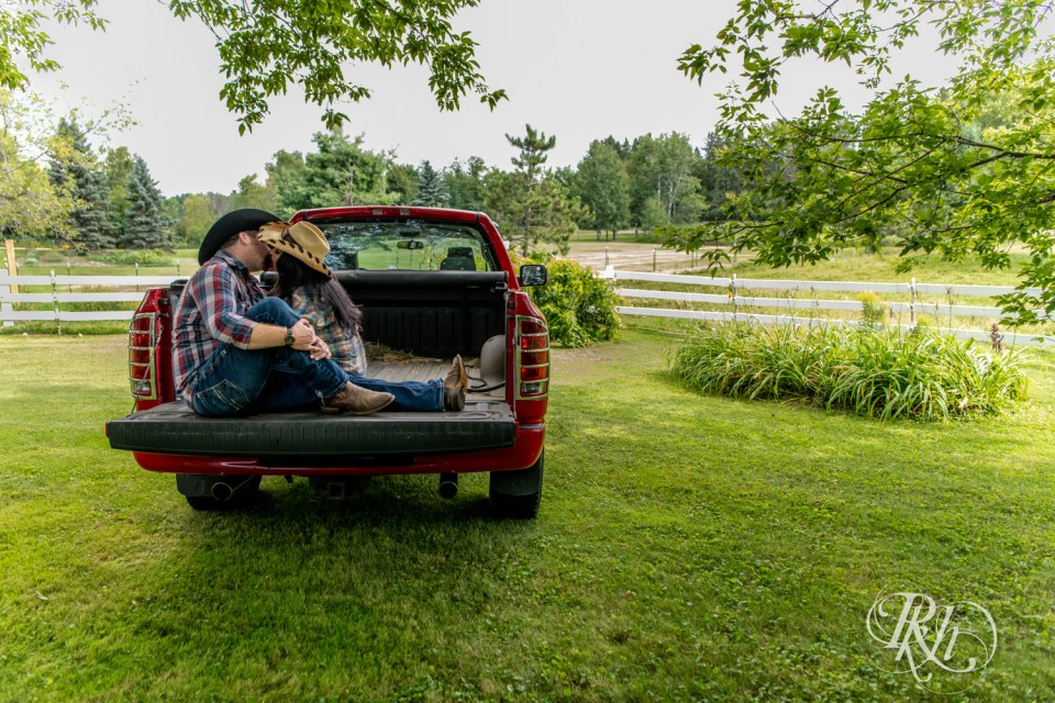 couple kissing in bed of truck
