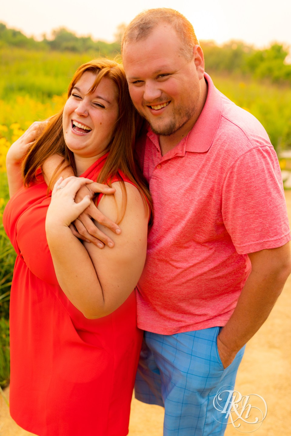 summer engagement photography couple laughing