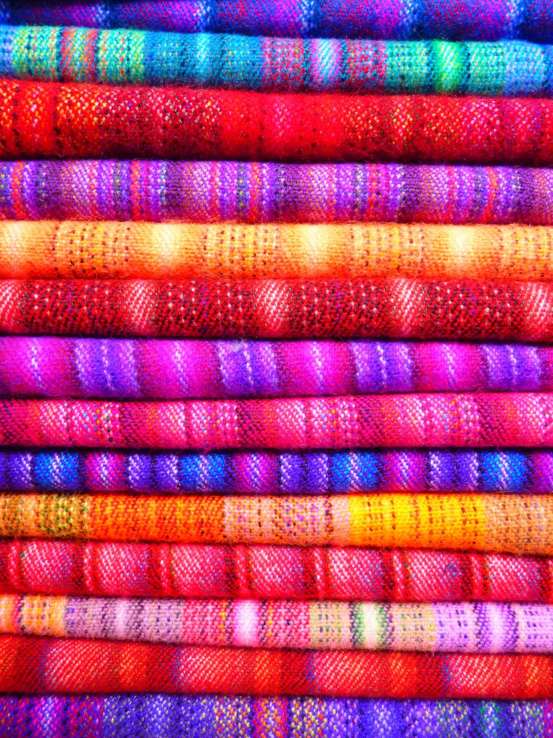 pink-and-blue-textile-near-yellow-textile-86757