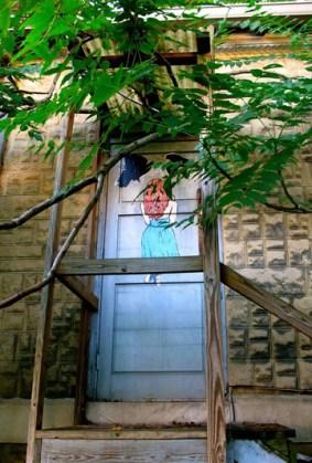 Final Girl door in trees