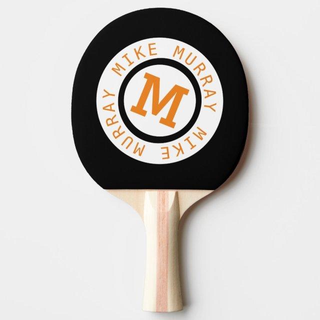 monogram on black ping pong paddle