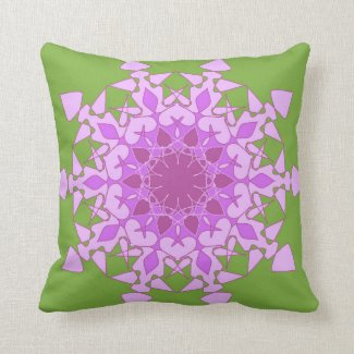 Artistic violet mandala on green throw pillows