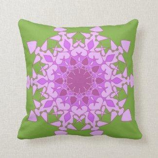 Artistic violet mandala on green throw pillows