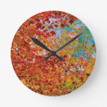 Beautiful Autumn Leaves Against Blue Sky Round Clock