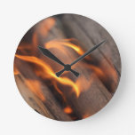 Burning wood branches round clock