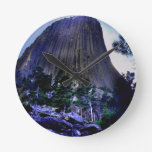 Dark Blue Sky and Ponderosa Pine at Devils Tower Round Wall Clocks